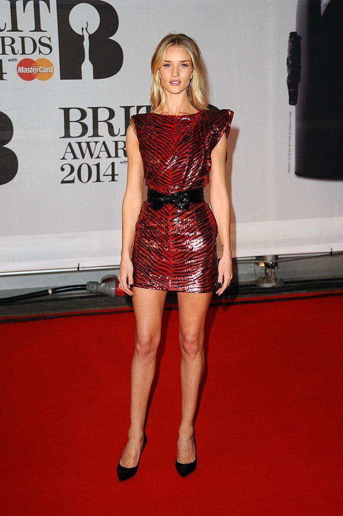 <p>The model's debit BRITs was in 2014 when she wore a Saint Laurent red sequin animal print mini dress on the red carpet. </p>