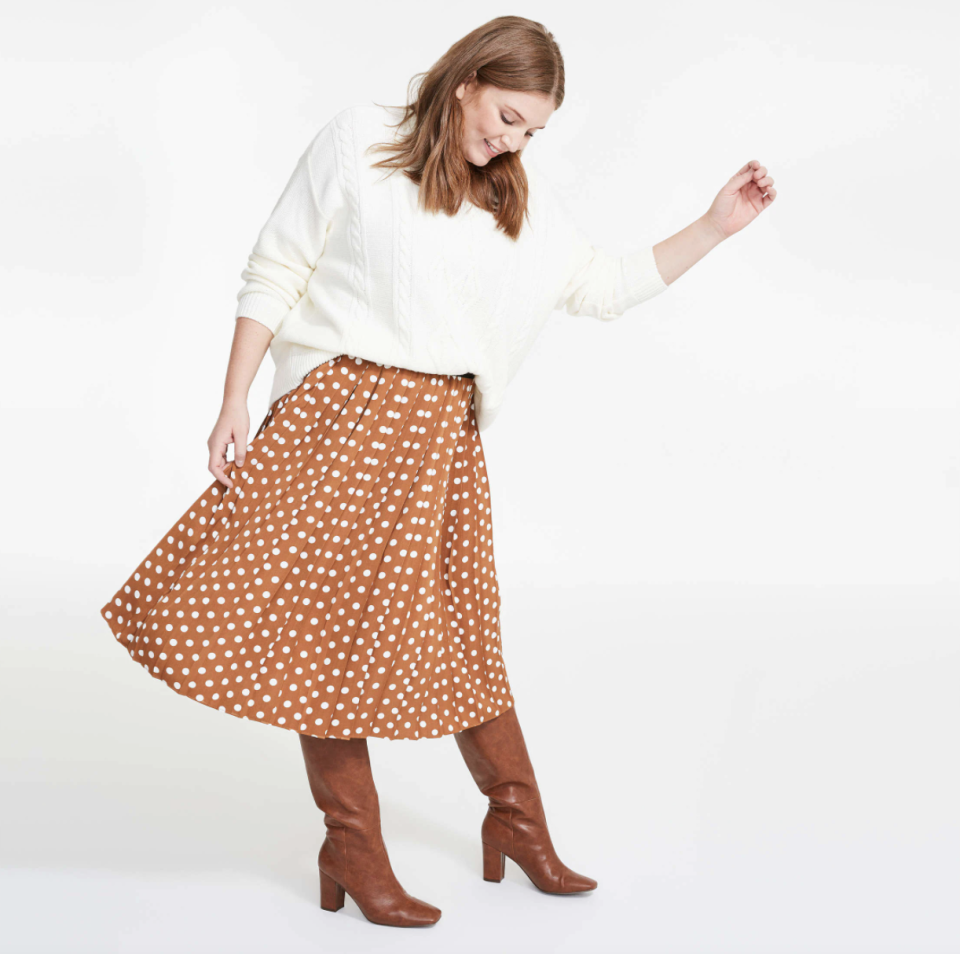 woman wearing black heel boots and polka dot Shannon Skirt