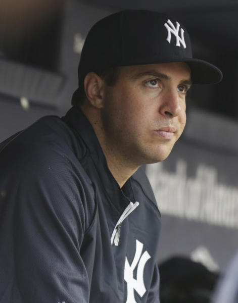 New York Yankees Mark Teixeira sits in the dugout during a baseball game against the Texas Rangers, Wednesday, June 26, 2013, in New York. Teixeira will have season-ending surgery on his right wrist, the Yankees and he announced in a news conference Wednesday. (AP Photo/Kathy Willens)