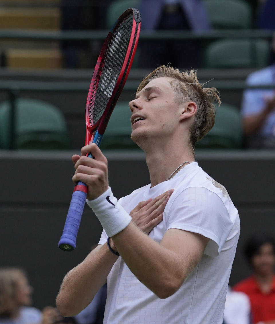 Canada's Denis Shapovalov celebrates after defeating Russia's Karen Khachanov during the men's singles quarterfinals match on day nine of the Wimbledon Tennis Championships in London, Wednesday, July 7, 2021. (AP Photo/Alastair Grant)