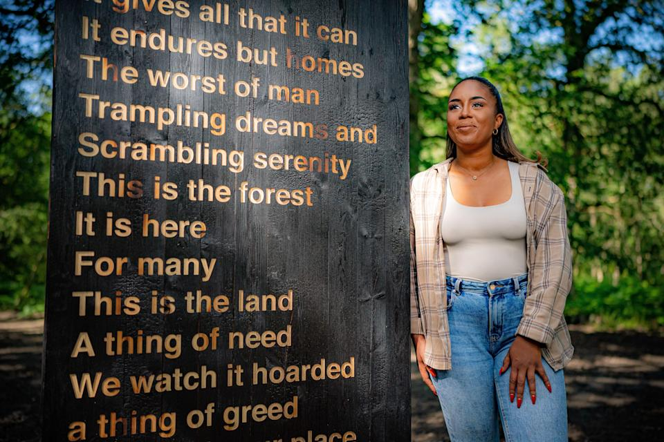 Artist Khady Gueye in the Forest of Dean, with her artwork, in collaboration with poet Zakiya McKenzie and the Sculpture Trust, titled 'Soil Unsoiled', reflecting racial and social economic inequalities in society and the experiences she has endured living in the Forest of Dean, as part of the 35th anniversary year of the sculpture trail at Forestry England's Beechenhurst site, due to be unveiled to the public on Monday. Picture date: Friday July 16, 2021. (PA Wire)