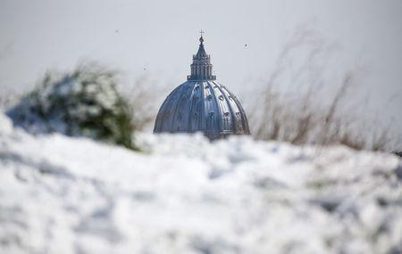 Saint Peter's Basilica dome is seen from afar after a heavy snowfall, in Rome, Italy February 26, 2018. REUTERS/Alessandro Bianchi