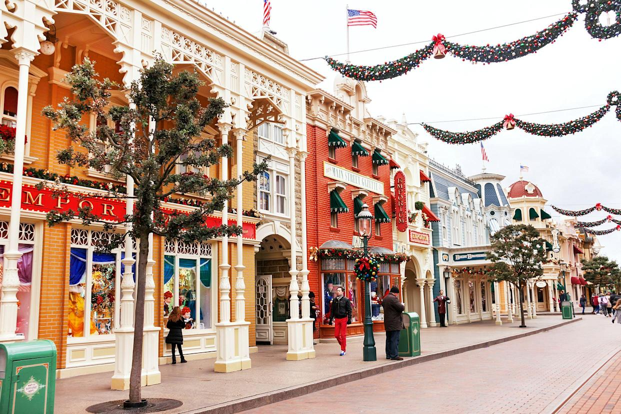 Paris, France - January 12, 2015:  Main street and shops of souvenirs are in the Disneyland Paris. Disneyland is one of  the most popular destinations in Paris. Travel (vacation), entertainment, childhood concept. France. Europe.