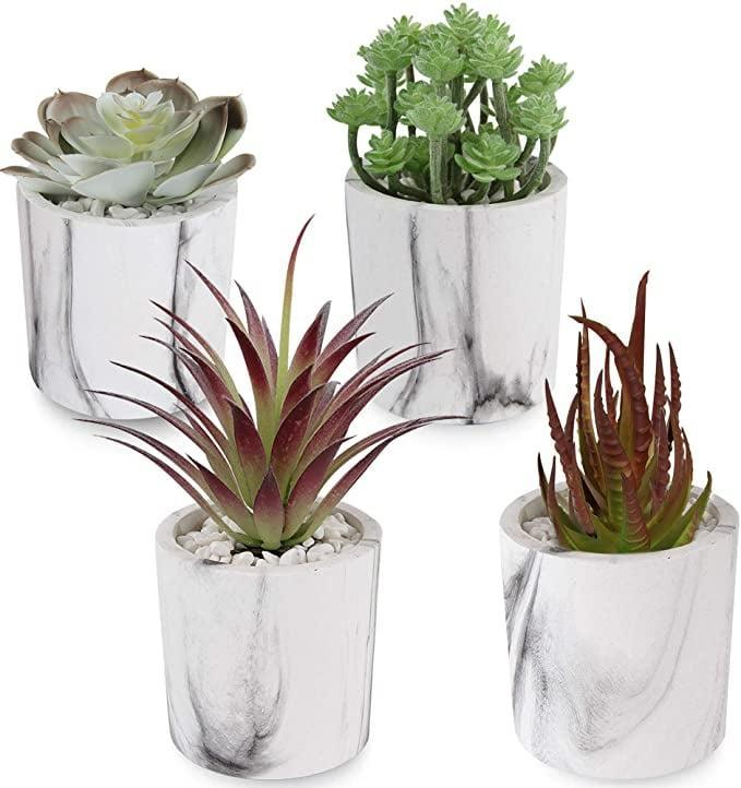 <p>If you love marble, these <span>Artificial Succulents Plants in Marble Pulp Pots</span> ($20) are gorgeous! Perfect for your work-from-home desk, on your dresser or bedside table.</p>