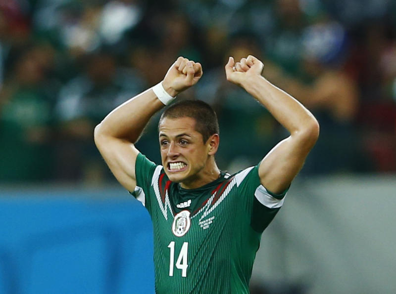 Mexico's Javier Hernandez celebrates after scoring a goal during their 2014 World Cup Group A soccer match against Croatia at the Pernambuco Arena in Recife June 23, 2014. REUTERS/Eddie Keogh (BRAZIL - Tags: SOCCER SPORT WORLD CUP TPX IMAGES OF THE DAY)