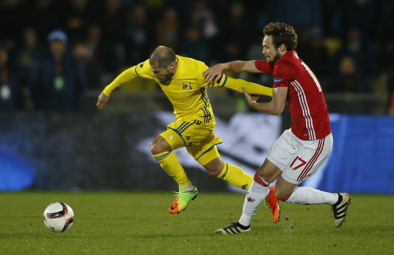 <p>Manchester United's Daley Blind tries to stop Rostov's Timofei Kalachev</p>