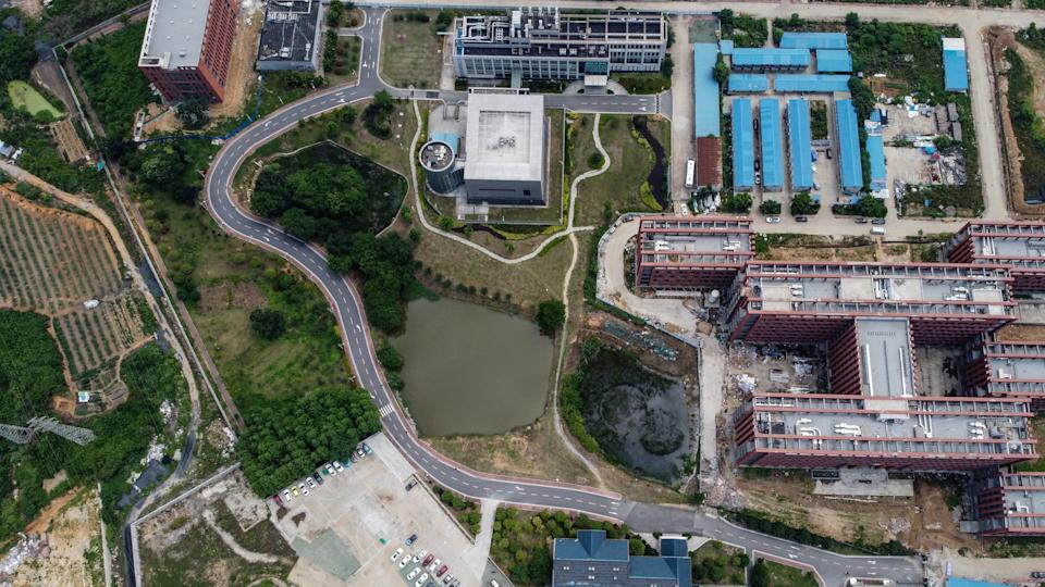 """This aerial view shows the P4 laboratory (top C) on the campus of the Wuhan Institute of Virology in Wuhan in China's central Hubei province on May 27, 2020. - Opened in 2018, the P4 lab conducts research on the world's most dangerous diseases and has been accused by some top US officials of being the source of the COVID-19 coronavirus pandemic. China's foreign minister on May 24 said the country was """"open"""" to international cooperation to identify the source of the disease, but any investigation must be led by the World Health Organization and """"free of political interference"""". (Photo by Hector RETAMAL / AFP) (Photo by HECTOR RETAMAL/AFP via Getty Images)"""