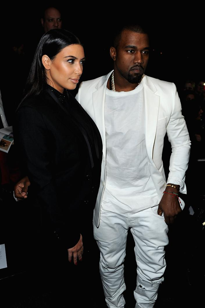 PARIS, FRANCE - MARCH 03: Kim Kardashian and Kanye West attend Givenchy Fall/Winter 2013 Ready-to-Wear show as part of Paris Fashion Week on March 3, 2013 in Paris, France. (Photo by Pascal Le Segretain/Getty Images)
