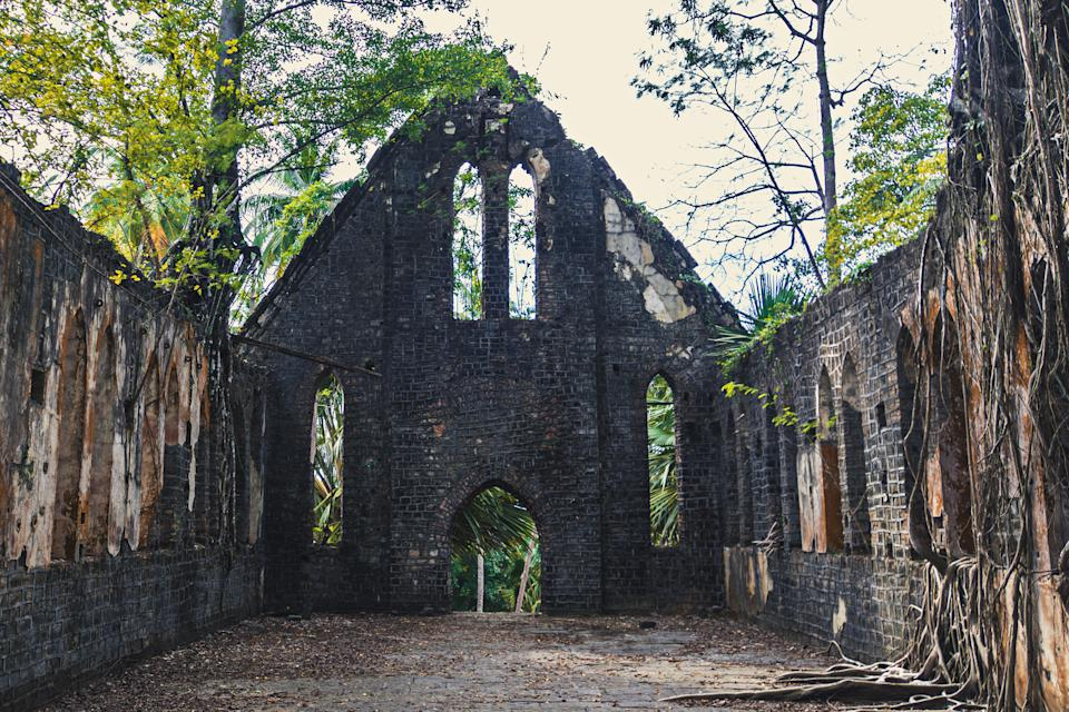 Ruins of abandoned Old British building covered with roots at Ross Island, Andaman Nicobar Islands, India