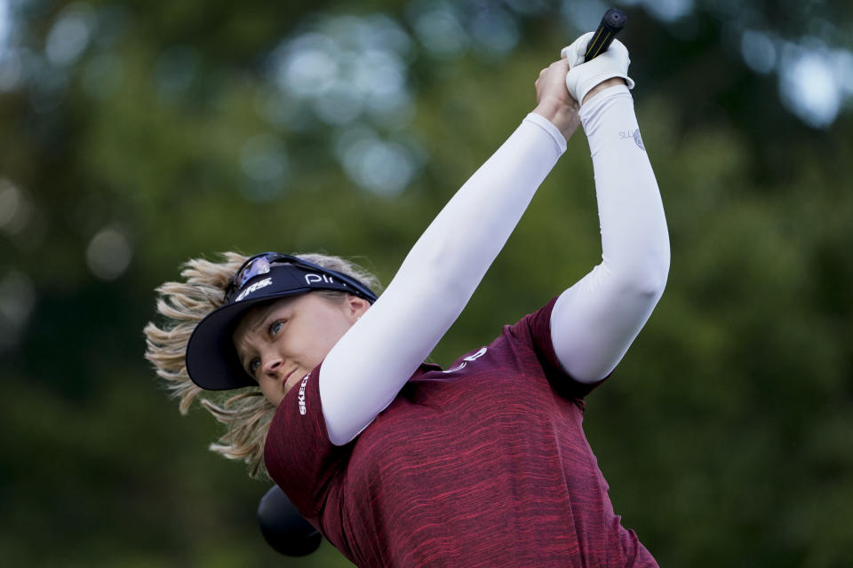 Brooke M. Henderson, of Canada, hits off the third tee in the first round of the Cognizant Founders Cup LPGA golf tournament, Thursday, Oct. 7, 2021, in West Caldwell, N.J. (AP Photo/John Minchillo)