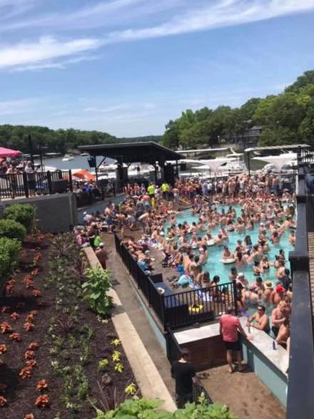 Hundreds attend a pool party at Backwater Jacks Bar & Grill at Osage Beach in Missouri.