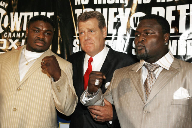 (L-R) James Toney, promoter Dan Goossen and Samuel Peter pose for a photo during a news conference in Los Angeles on Tuesday, July 11, 2006. (AP Photo/Nick Ut)