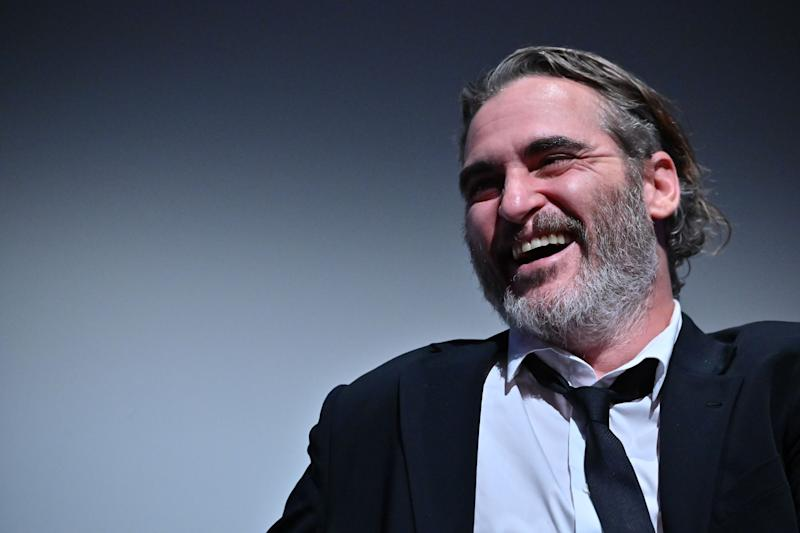 Joaquin Phoenix lets out a dashing smile for the camera in this photo and he looks amazing