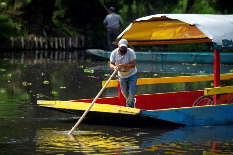 Xochimilco is a UNESCO World Heritage Site that draws tourists for trips on colorful gondolas