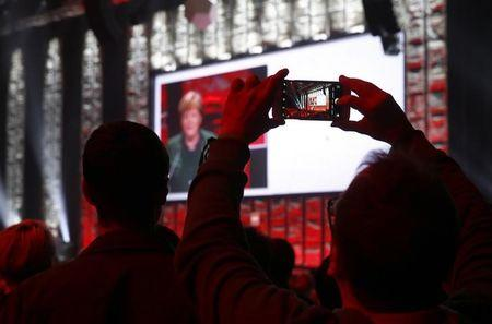 German Chancellor Angela Merkel speaks during the opening ceremony of the CeBit computer fair, which will open its doors to the public on March 20, at the fairground in Hanover, Germany, March 19, 2017.     REUTERS/Morris Mac Matzen