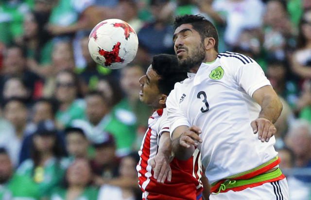 Mexico defender Jair Pereira (3) battles for header with Paraguay midfielder Nestor Camacho, left, in the first half of an international friendly soccer match, Saturday, July 1, 2017, in Seattle. (AP Photo/Ted S. Warren)