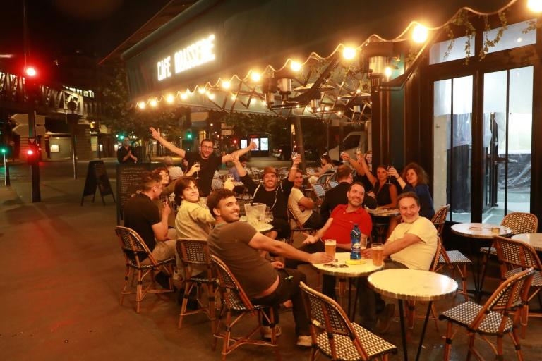 Street life: Parisians enjoys their first drink on a terrace at the 'Royal Cambronne', a Brasserie that reopened at midnight on June 2 (AFP Photo/Ludovic MARIN)