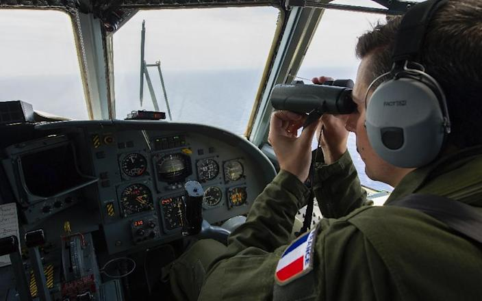 A French soldier searches for debris from the crashed EgyptAir flight MS804 over the Mediterranean Sea (AFP Photo/Alexandre Groyer)