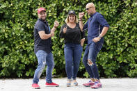 Tirso Luis, left, Ana Paez, and German Pinelli, right, members of the band Los 3 de la Habana, pose for a photograph, Thursday, Oct. 22, 2020, in Miami. The Cuban artists who sought asylum in the U.S. have composed a salsa song in support of President Donald Trump, which is now being used as a full-fledged campaign ad. (AP Photo/Lynne Sladky)