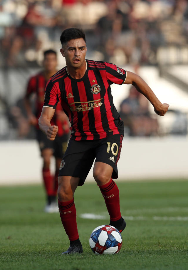 Atlanta United midfielder Gonzalo Martinez (10) moves the ball during the first half of a U.S. Open Cup Quarterfinal soccer match against the Saint Louis FC Wednesday, July 10, 2019, in Kennesaw, Ga. (AP Photo/John Bazemore)