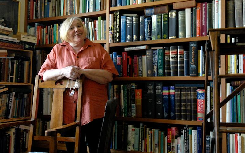 Author Fay Weldon in her library  - Credit: Getty