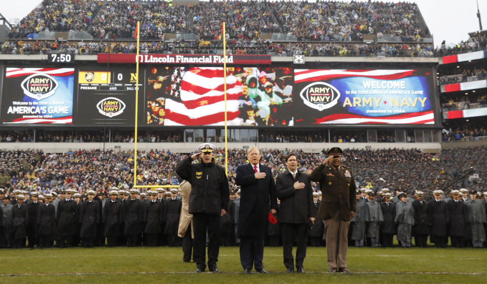 President Donald Trump stands for the Pledge of Allegiance before the start of the Army-Navy college football game in Philadelphia on Saturday. (AP Photo/Jacquelyn Martin)