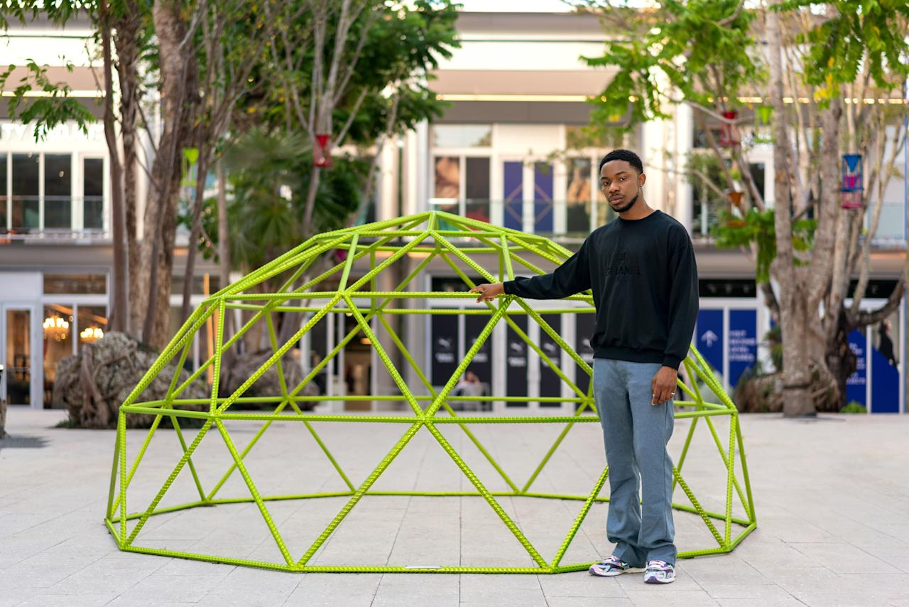 "Though at first glance the brightly colored structures that the Houston-born, Portugal-based designer has devised for Miami's Design District might look like playful jungle gyms, they are not as simple as they seem: Dozie Kanu has collaborated with Caliber Foundation, a nonprofit that supports victims of gun violence, to create the pieces out of the metal from decommissioned firearms. ""I wanted to make pieces that were familiar to children but had a deeper meaning,"" the designer <a rel=""nofollow"" href=""https://www.architecturaldigest.com/story/discover-the-world-of-dozie-kanu?mbid=synd_yahoo_rss"">told <em>AD</em> last month.</a>"
