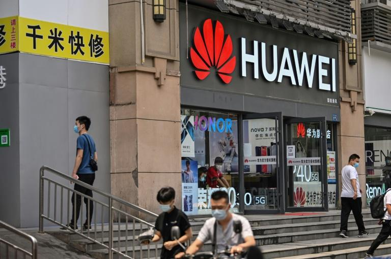 Chinese tech giant Huawei is at the center of a Washington-Ottawa-Beijing diplomatic row over the extradition of a Huawei exec from Canada to the United States for lying to a bank (AFP Photo/Hector RETAMAL)
