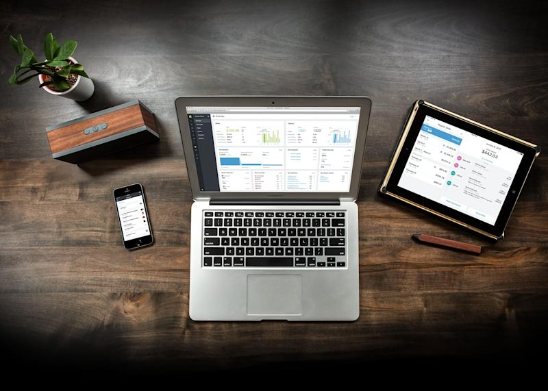 A laptop, tablet, and smartphone all displaying the Shopify e-commerce platform