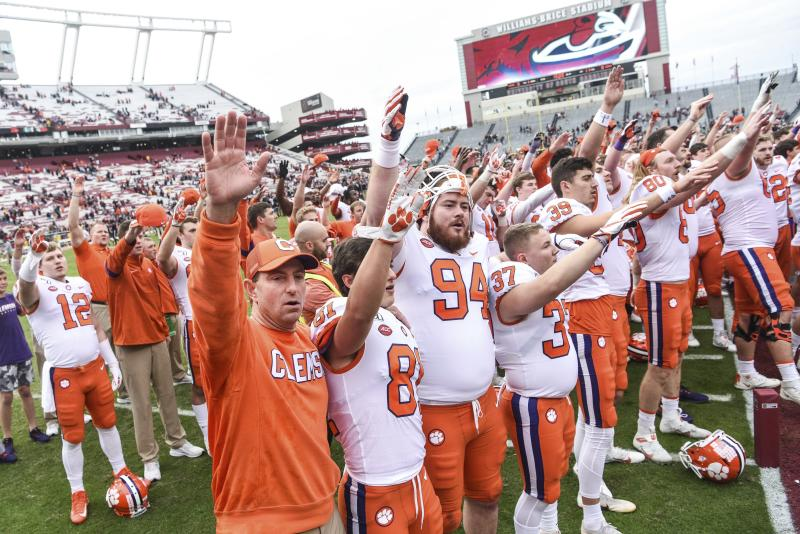 Clemson head coach Dabo Swinney celebrates with players after an NCAA college football game against South Carolina on Nov. 30. (AP)
