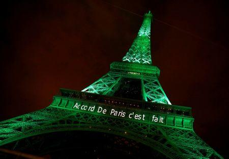 """The Eiffel tower is illuminated in green with the words """"Paris Agreement is Done"""", to celebrate the Paris U.N. COP21 Climate Change agreement in Paris"""