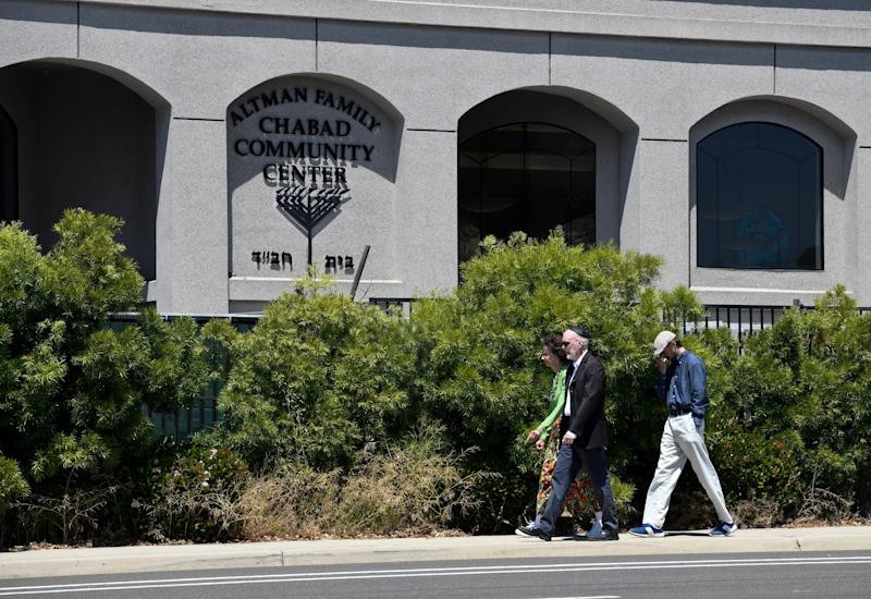Synagogue members walk outside of the Chabad of Poway Synagogue Saturday, April 27, 2019, in Poway, Calif.