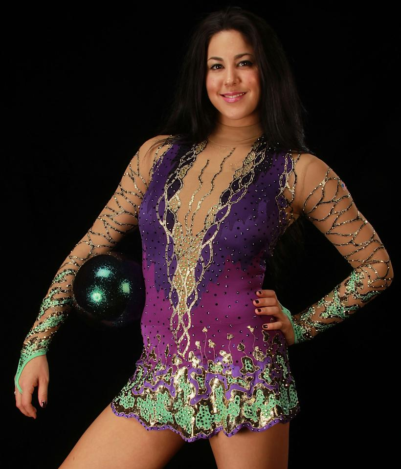 """21-year-old Julie Zetlin is an aspiring actress and Team USA rhythmic gymnast.  After London, she plans to retire from gymnastics, move to LA, and pursue acting fulltime.  She caught the acting bug at 4 years old when she landed a Welch's grape juice TV commercial.  Despite injuries and knee surgery, Zetlin earned a wild-card berth at the London Games.  Asked about Will Ferrell's rhythmic gymnastics in Old School, Zetlin said, """"He didn't do a very good job, though it's very funny.""""  (Photo by Ronald Martinez/Getty Images)"""