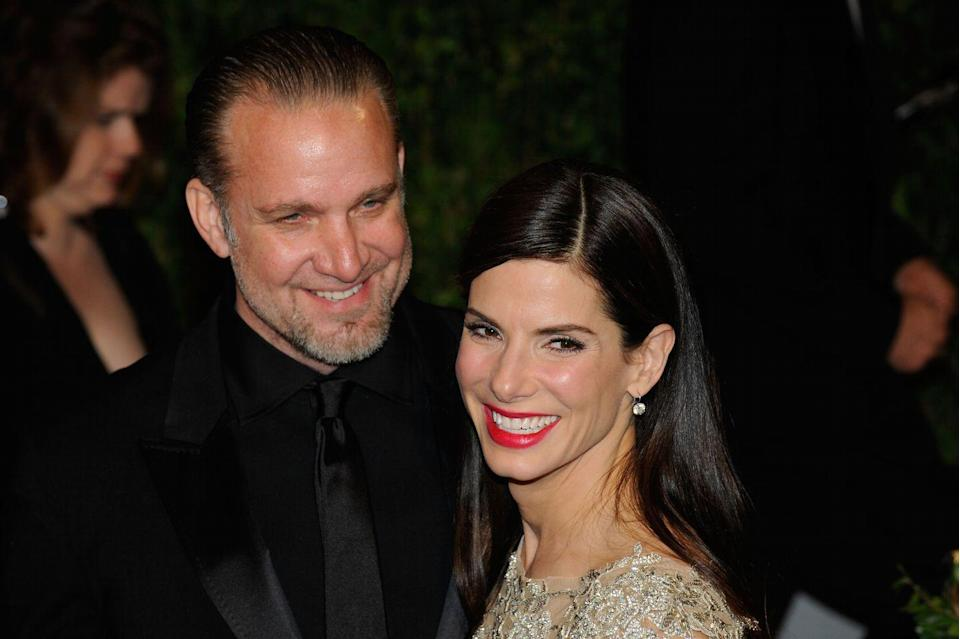 "<p>Sandra Bullock had just earned an Oscar for her role in <em>The Blind Side</em> when <a href=""http://abcnews.go.com/Nightline/sandra-bullock-jesse-james-timeline/story?id=10730006"" rel=""nofollow noopener"" target=""_blank"" data-ylk=""slk:reports surfaced"" class=""link rapid-noclick-resp"">reports surfaced</a> in March 2010 that her husband, <em>Monster Garage</em> host Jesse James, had cheated with Michelle ""Bombshell"" McGee. James confirmed the affair with a public apology, but four more women were soon named as mistresses. By the end of April, Bullock had filed for divorce.</p>"