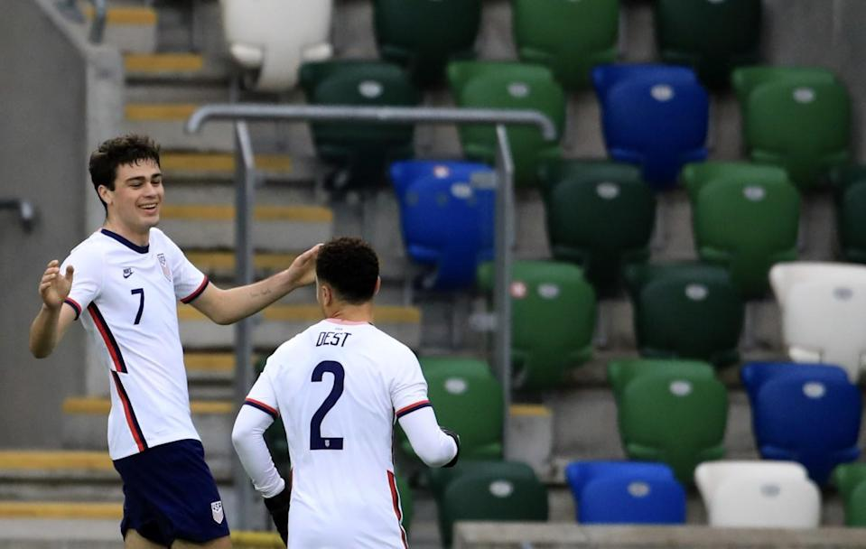 United States's Gio Reyna, left, celebrates with Sergino Dest after scoring