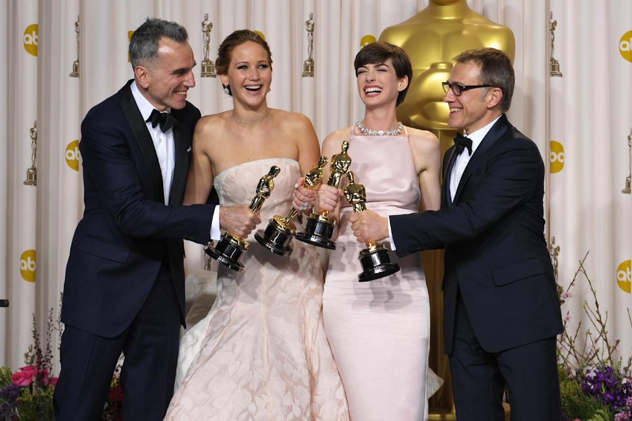 """From left, Daniel Day-Lewis, with his award for best actor in a leading role for """"Lincoln,"""" Jennifer Lawrence, with her award for best actress in a leading role for """"Silver Linings Playbook,"""" Anne Hathaway, with her award for best actress in a supporting role for """"Les Miserables,"""" and actor Christoph Waltz,with his award for best actor in a supporting role for """"Django Unchained,"""" pose during the Oscars at the Dolby Theatre on Sunday Feb. 24, 2013, in Los Angeles. (Photo by John Shearer/Invision/AP)"""