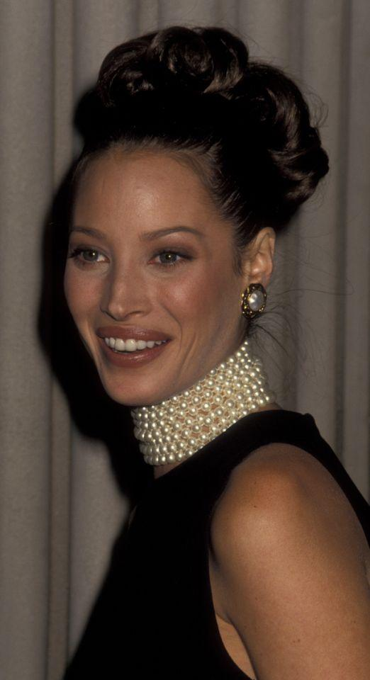 <p>Brownish-nude lipstick, a prom-style updo, and pearl choker made this '90s look a win for this supermodel. She was wise to keep her makeup simple. </p>
