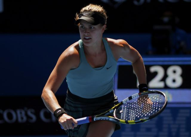 Eugenie Bouchard of Canada chases a return to Ana Ivanovic of Serbia during their women's quarter-final tennis match at the Australian Open 2014 tennis tournament in Melbourne January 21, 2014. REUTERS/Petar Kujundzic (AUSTRALIA - Tags: SPORT TENNIS)