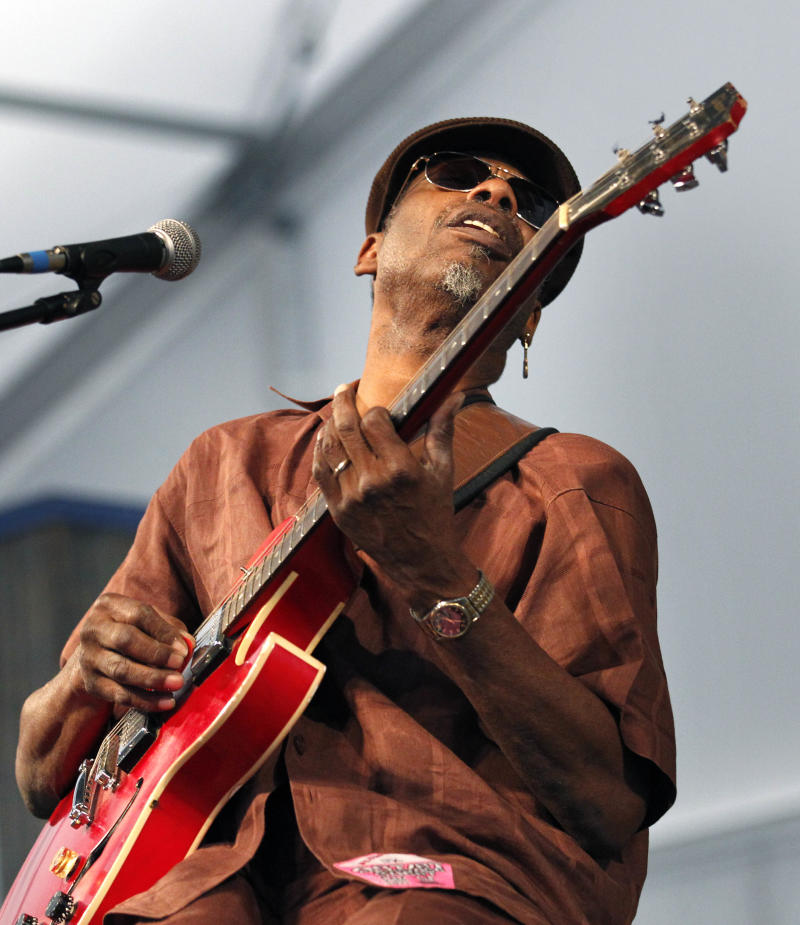 Blues guitarist and singer Walter 'Wolfman' Washington performs with the Joe Krown Trio at the Louisiana Jazz and Heritage Festival in New Orleans, Friday, April 29, 2011. (AP Photo/Gerald Herbert)