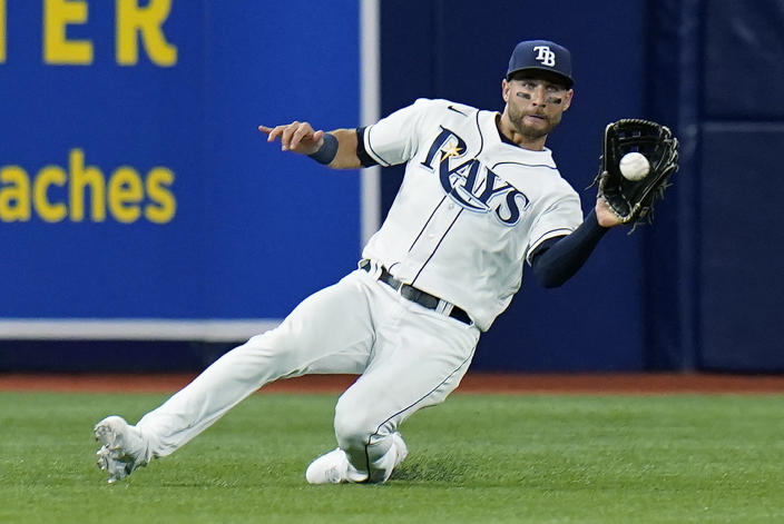 Tampa Bay Rays center fielder Kevin Kiermaier (39) makes a sliding catch on a fly out by Baltimore Orioles' Anthony Santander during the third inning of a baseball game Friday, June 11, 2021, in St. Petersburg, Fla. (AP Photo/Chris O'Meara)