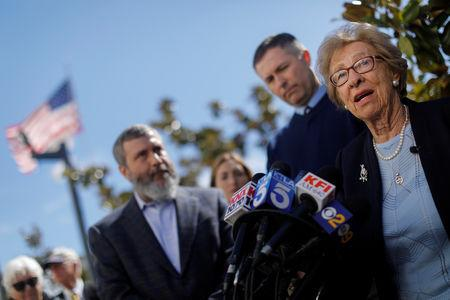 Auschwitz survivor Eva Schloss, stepsister of Holocaust diarist Anne Frank, talks to the media at Newport Harbor High School after speaking with a group of students seen in viral online photos giving Nazi salutes over a swastika made of red cups that sparked outrage in Newport Beach, California, U.S., March 7, 2019. REUTERS/Mike Blake