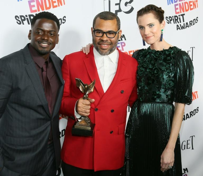 """Daniel Kaluuya (L) earned his first Oscar nomination for his work in race-based horror film """"Get Out"""" opposite Allison Williams (R), which was written and directed by Jordan Peele (C)"""
