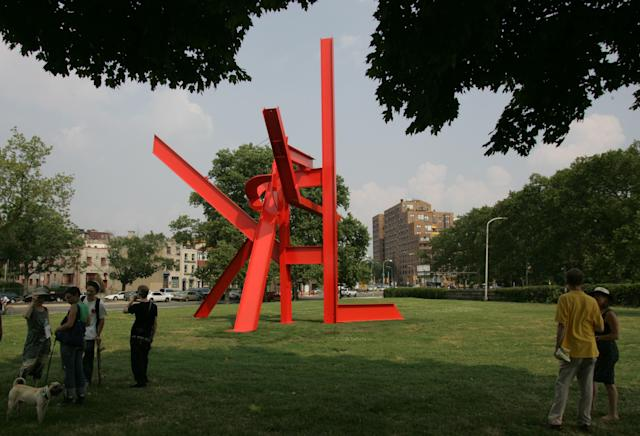 "People look at ""Iroquois,"" a 40-foot sculpture by Mark di Suvero, before ceremonies as the Fairmount Park Art Association dedicated it on Wednesday, June 27, 2007, in Philadelphia. (AP Photo/George Widman)"