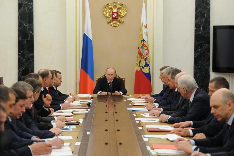 Russian President Vladimir Putin, center, chairs a Security Council meeting in the Kremlin in Moscow, Russia, Tuesday, April 22, 2014. (AP Photo/RIA-Novosti, Mikhail Klimentyev, Presidential Press Service)