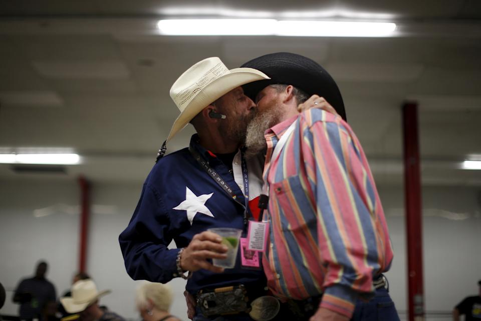 "Gordon Satterly, 61, from Michigan (L) kisses his husband Richard Brand, 53, from Texas, at the International Gay Rodeo Association's Rodeo In the Rock party in Little Rock, Arkansas, United States April 24, 2015. Contestants at the International Gay Rodeo in Arkansas, a Bible Belt state with a same-sex marriage ban on its books, competed in events from barrel racing to bull riding on the soft soil of a fairground that looked like just any small-scale rodeo held throughout the United States. The U.S. Supreme Court is expected to rule in June whether to strike down bans on gay marriage nationwide. Arkansas has been one of the front-line states in the battle between cultural conservatives and those seeking expanded rights for the lesbian, gay, bisexual and transgender (LGBT) community. REUTERS/Lucy Nicholson TPX IMAGES OF THE DAY  PICTURE 26 OF 27 FOR WIDER IMAGE STORY ""GAY RODEO IN LITTLE ROCK""  SEARCH ""RODEO LUCY"" FOR ALL IMAGES      TPX IMAGES OF THE DAY"