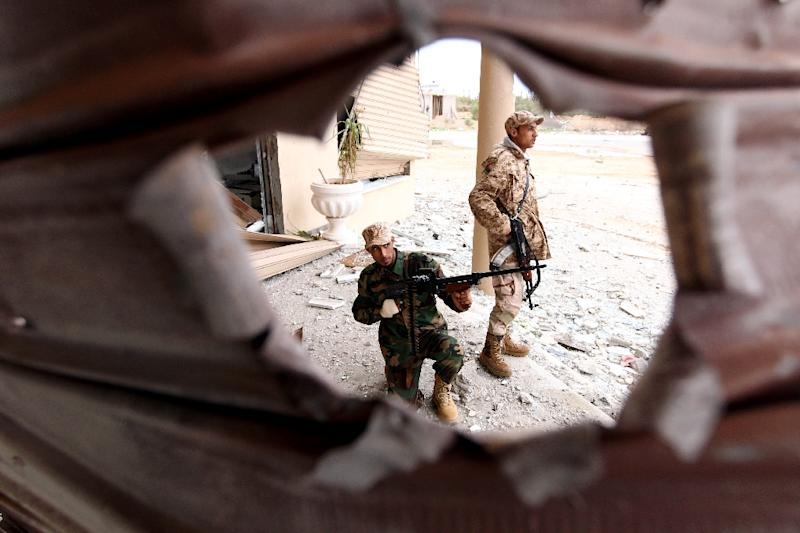 Troops loyal to Khalifa Haftar, a retired general and former chief of staff for Moamer Kadhafi, pose for picture as they fight alongside the Libyan army in clashes with Islamist gunmen in the eastern Libyan city of Benghazi on December 16, 2014 (AFP Photo/Abdullah Doma)