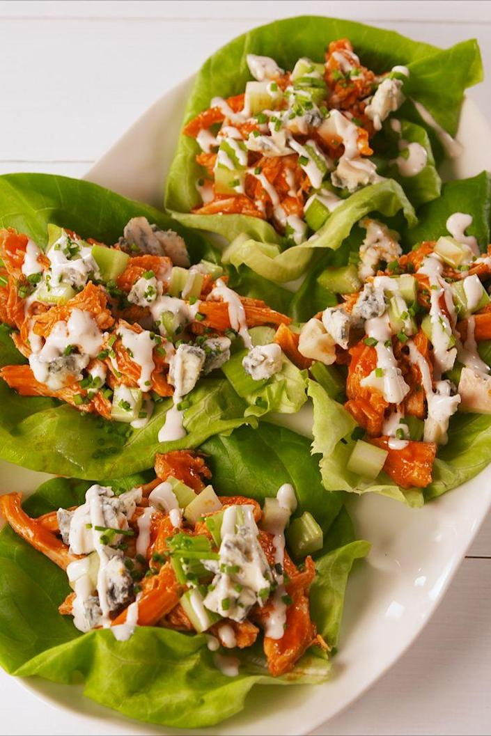 """<p>Spice up your life.</p><p>Get the recipe from <a href=""""https://www.delish.com/cooking/a19645010/buffalo-chicken-lettuce-wraps-recipe/"""" rel=""""nofollow noopener"""" target=""""_blank"""" data-ylk=""""slk:Delish"""" class=""""link rapid-noclick-resp"""">Delish</a>. </p>"""