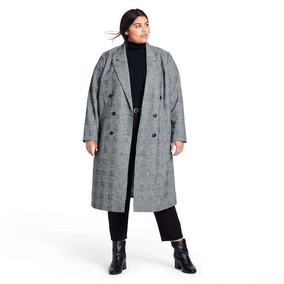 <p>Behold, your perfect winter coat: the <span>Nili Lotan x Target Plaid Double Breasted Overcoat</span> ($80) is always a good idea. The classic coat will look good on top of any outfit.</p>