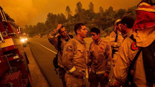PHOTO: Firefighters discuss plans while battling the Carr Fire in Shasta, Calif., on Thursday, July 26, 2018. (Noah Berger/AP)