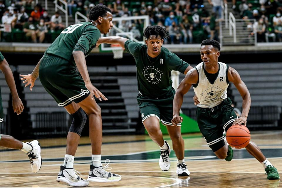 Michigan State's Tyson Walker, right, moves past A.J. Hoggard, center, and Marcus Bingham Jr. during open practice on Saturday, Oct. 2, 2021, at the Breslin Center in East Lansing.